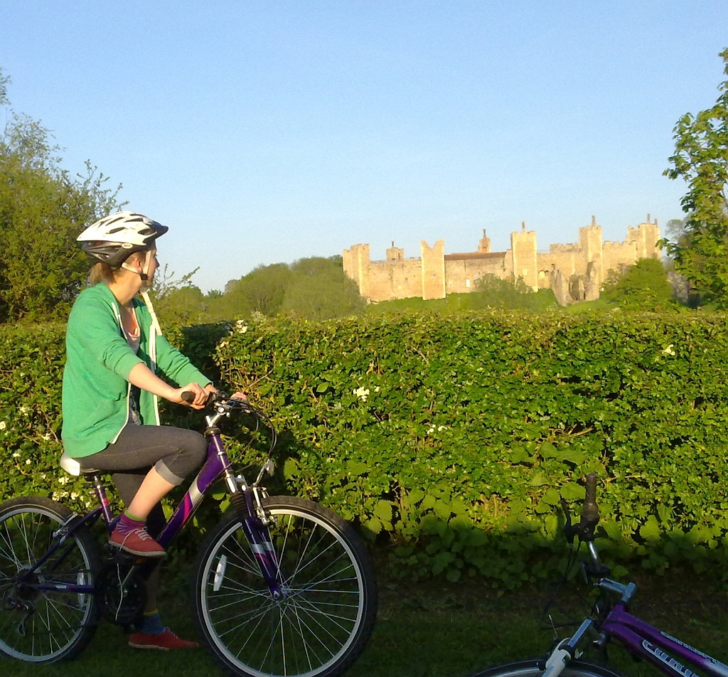 Cyclist admiring Framlingham Castle Suffolk by Xtrahead